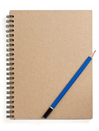 pencil on checked notebook isolated at white background photo