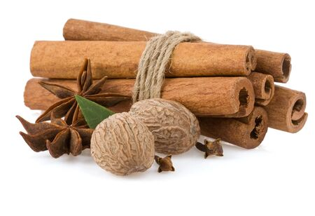 cinnamon sticks, anise star and nutmeg isolated on white background photo