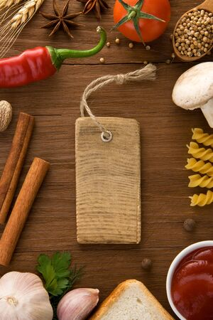 tag price and food ingredients on wooden table photo