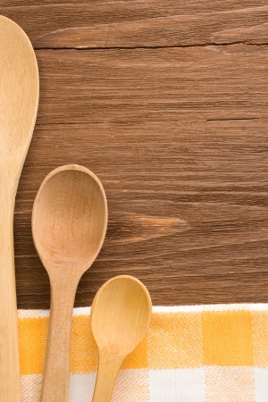 wood spoon as utensils on wooden background Stock Photo - 15585571