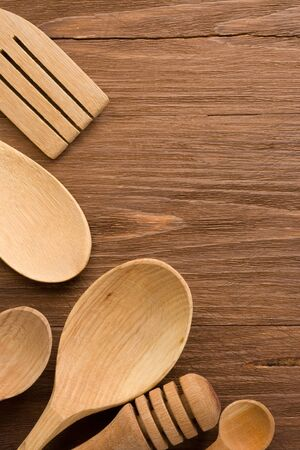 wood utensils on wooden background texture Stock Photo - 15585596