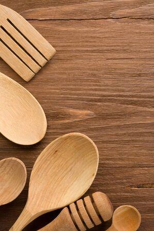 wood utensils on wooden background texture Stock Photo - 15585596