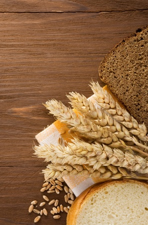 sliced bread and ears of wheat on napkin photo