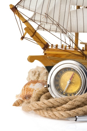 ship rope and compass isolated on white background photo