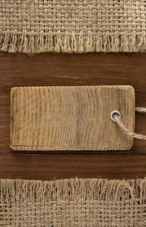 hessian: price tag on wood background Stock Photo