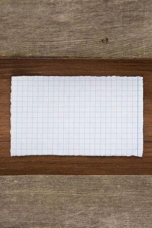 note paper on wood background photo