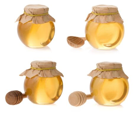 honey jar isolated on white background photo