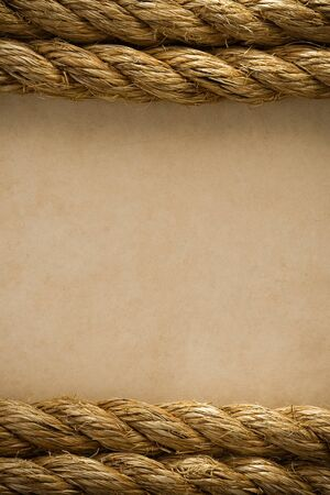 ropes on old vintage ancient paper background texture photo