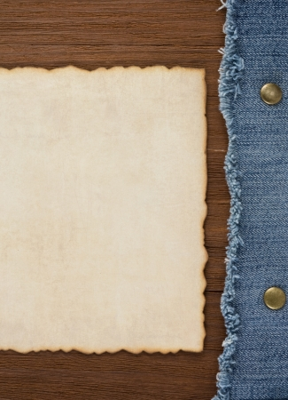 blue jean on wood texture background photo