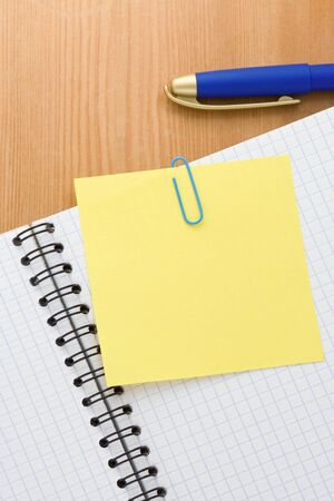 note paper and checked pad on wood background Stock Photo - 16302035