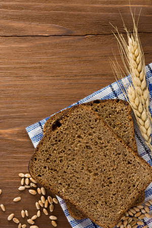 ear checked: rye bread and ears of wheat on napkin Stock Photo