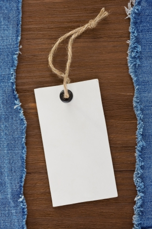 blue jean and price tag on wood texture background Stock Photo - 16657779