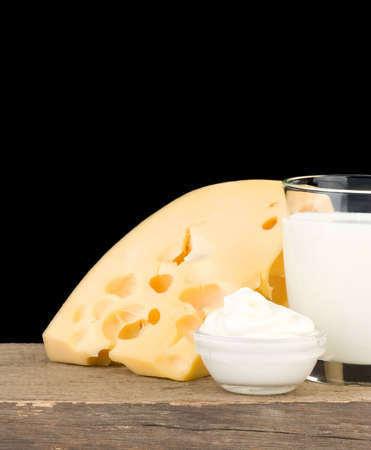 milk products cheese isolated on black background photo