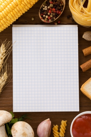 notebook for cooking recipes and spices on wooden table Stock Photo - 16657710