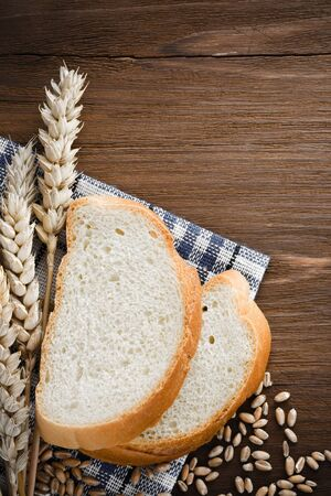 ear checked: sliced bread and ears of wheat on napkin