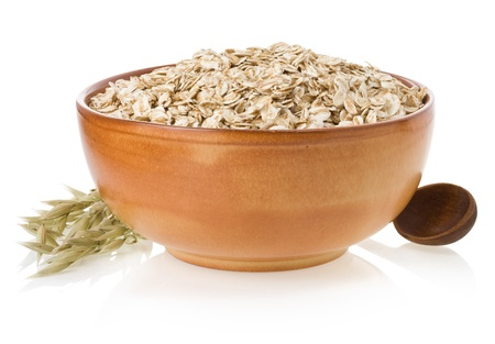 bowl of oat flake isolated on white background photo
