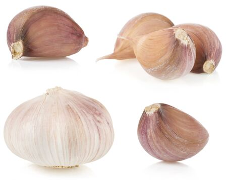 garlic cloves isolated on white background photo