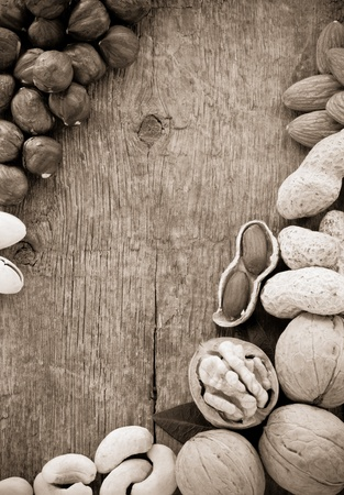 variety of nuts on wood background photo