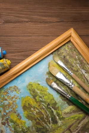 brush and painting  on wood background Stock Photo - 17283054