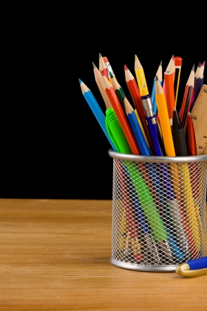 holder basket and school supplies isolated on black background Stock Photo - 17301552