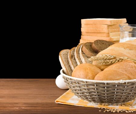 fresh bread isolated on black background photo