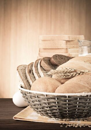 fresh bread on wood background photo