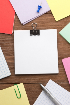 note paper and office accessories on wood background Stock Photo - 17602859