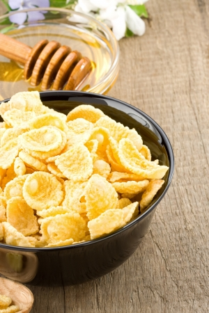 bowl of corn flakes and nutrition on wooden background Stock Photo - 18200640