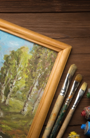 brush and painting  on wood background Stock Photo - 18200858