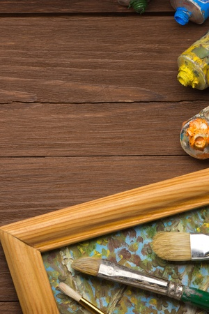 brush and painting  on wood background Stock Photo - 18200879