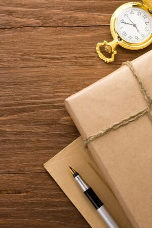 parcel wrapped with brown paper at wood background photo