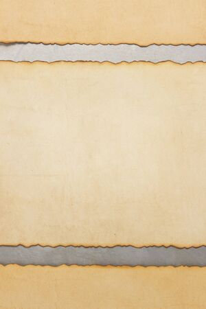 aged parchment paper on metal background photo