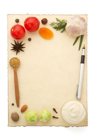 food ingredients and recipe paper on white background photo