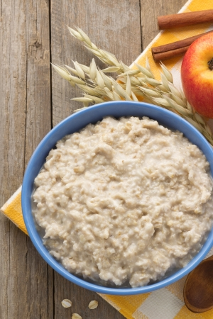 bowl of oatmeal on wood background photo