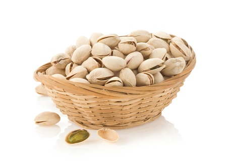 nuts pistachios isolated on white background photo