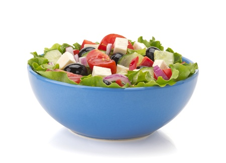 salad in bowl isolated on white background photo