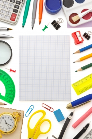 notebook and school  supplies isolated on white background photo
