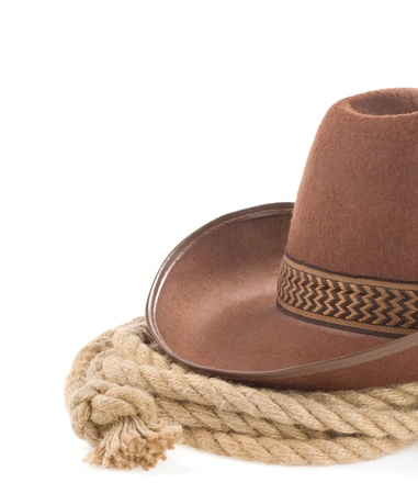 western attire: brown cowboy hat and rope isolated on white background