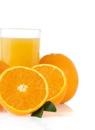 orange juice in glass isolated on white background photo