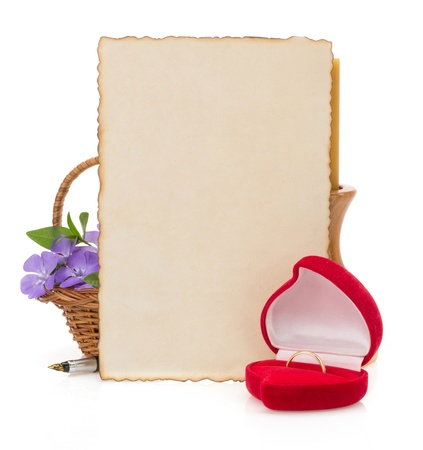wedding ring and aged paper isolated on white Stock Photo - 20103533