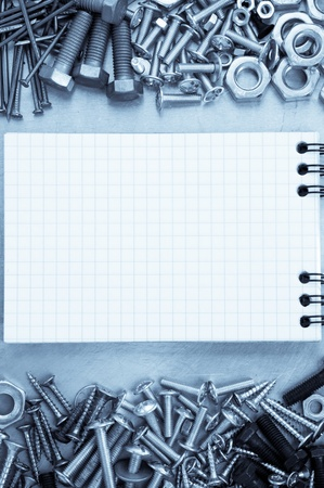 metal construction  hardware tool and blank notebook photo