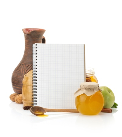 a jar stand: cooking recipes book and food isolated on white background