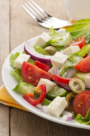 greek salad on wood background photo
