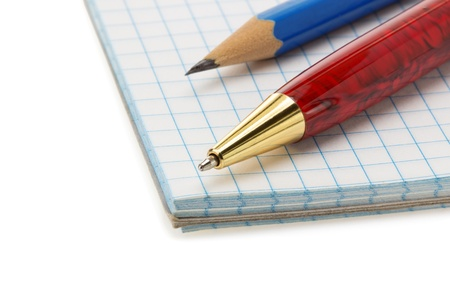 school supplies on checked notebook isolated at white background Stock Photo - 21272037