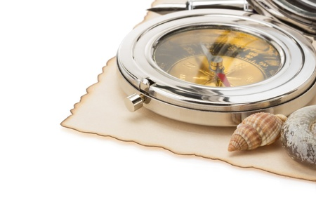 seashell and compass on old paper isolated at white background photo