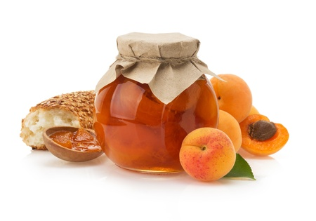 apricot jam isolated on white background photo