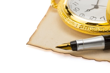 watch and pen at vintage parchment isolated on white background photo