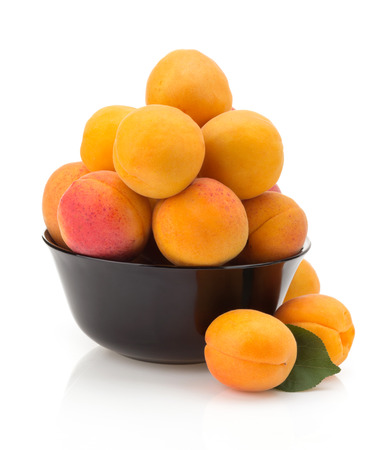 velvety: apricot in bowl isolated on white background Stock Photo