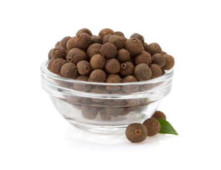 allspice in bowl isolated on white background photo
