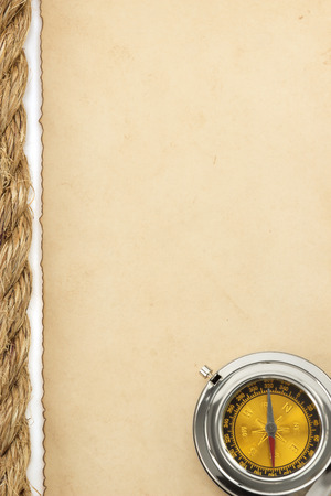 ropes and old paper isolated on white background photo